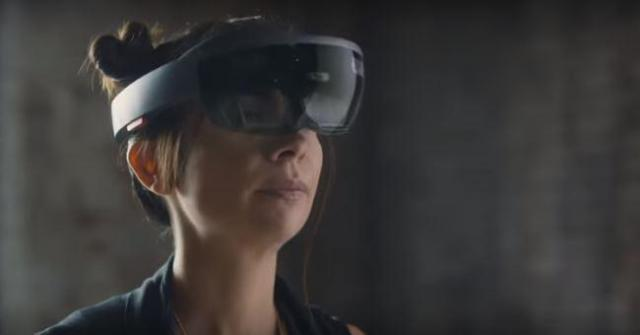 A lady tries on the HoloLens in a promotional Microsoft video