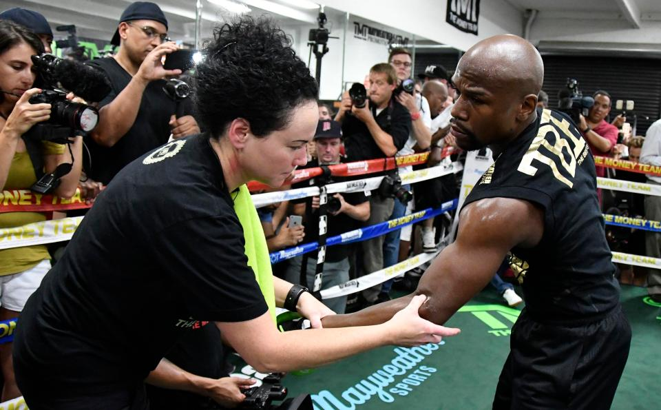 Floyd Mayweather is examined during an open training session at the T-Mobile Arena
