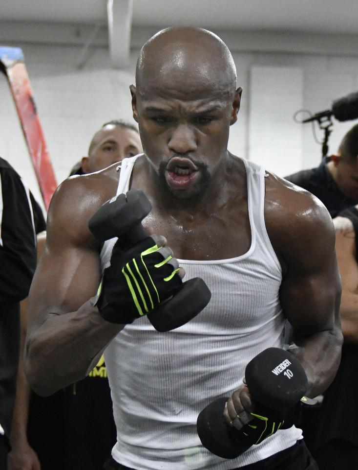 Floyd Mayweather lifts weights at the T-Mobile Arena in Las Vegas