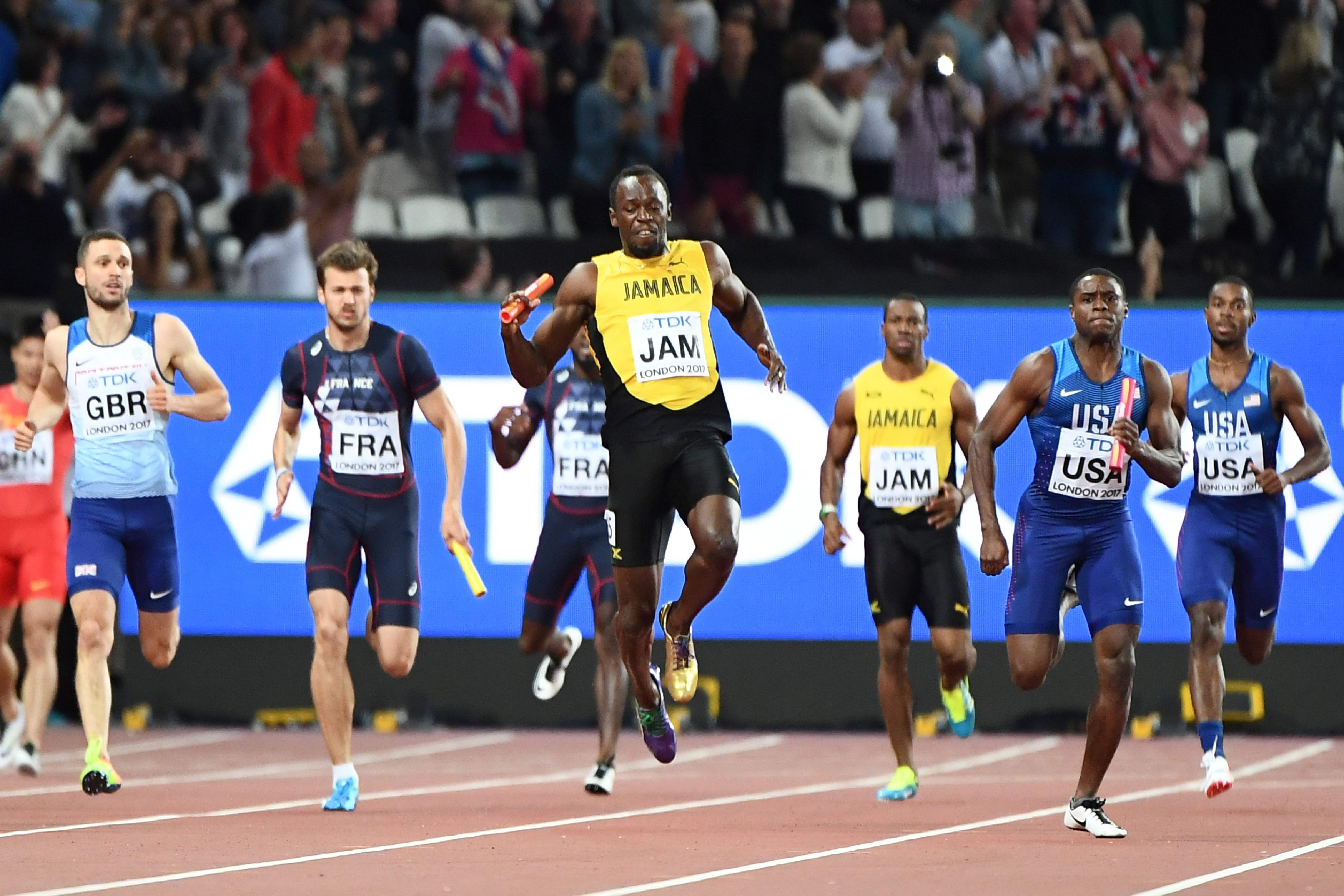 Usain Bolt winces in agony as his he pulls up injured in his final ever race