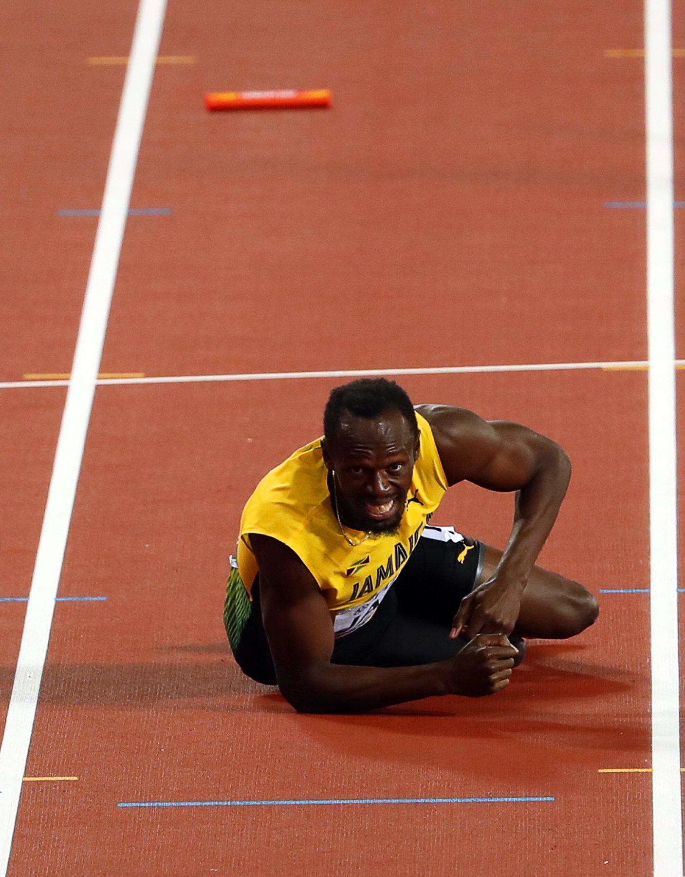 Usain Bolt can only look and watch as Britain beat America to gold