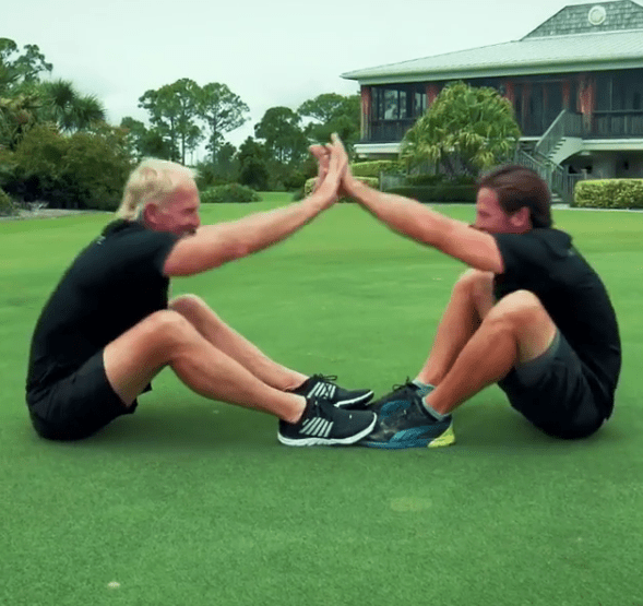 The double Open champion and his son show off their fitness in the video