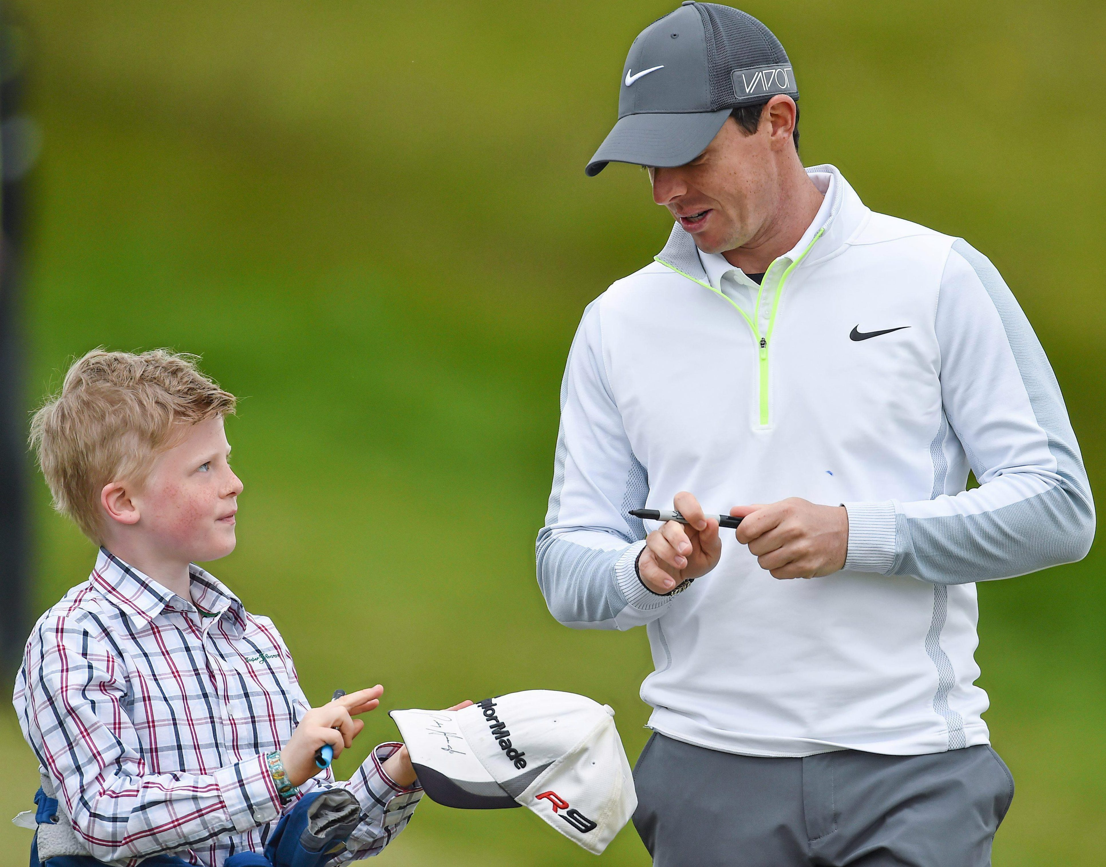 Rory McIlroy signs an autograph for a keen fan... unlike Roy Keane back in the day
