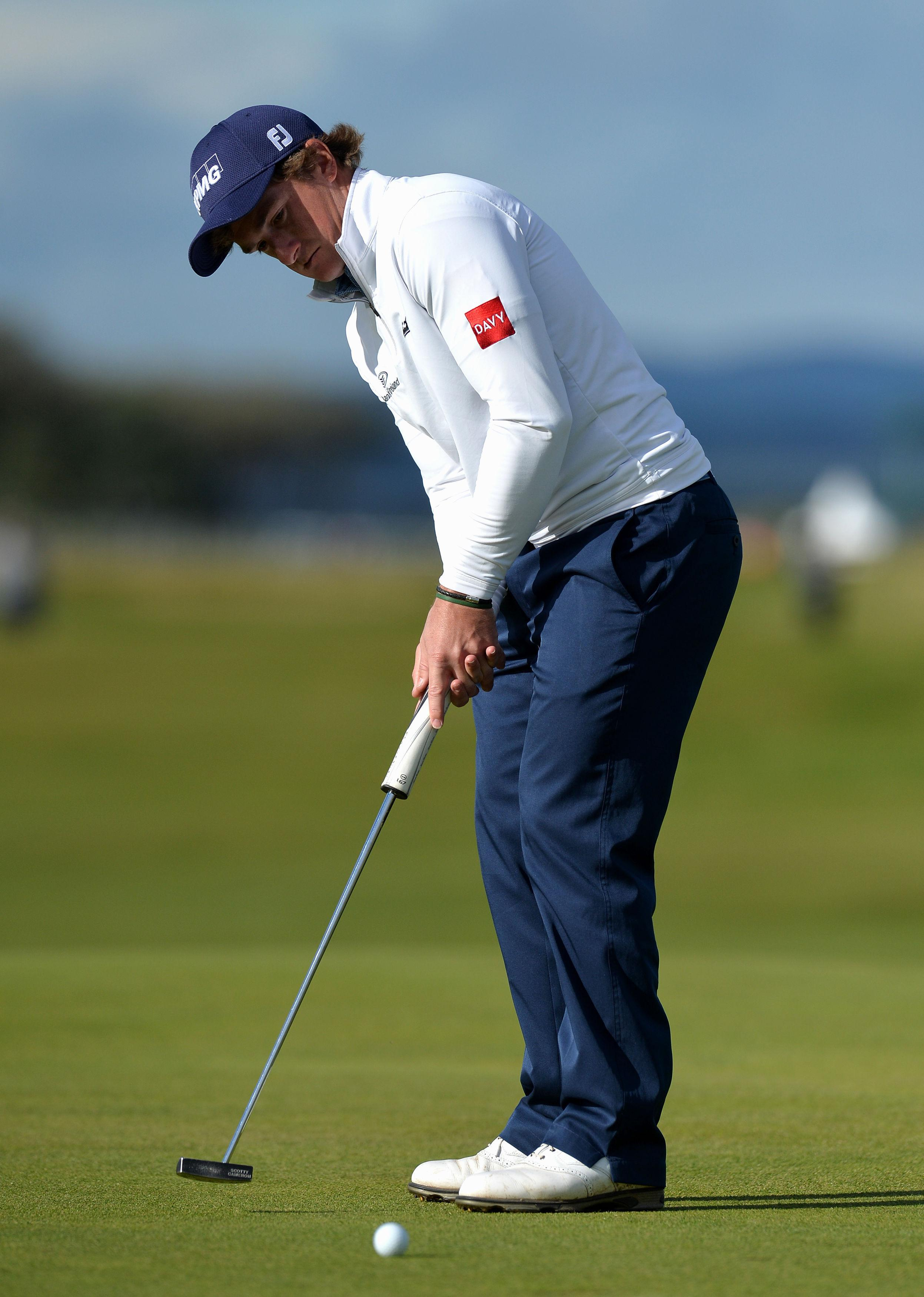 Paul Dunne putts on the seventeenth green