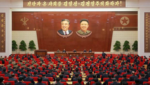 He spoke under giant images of his father and grandfather amid claims he is planning a further missile launch