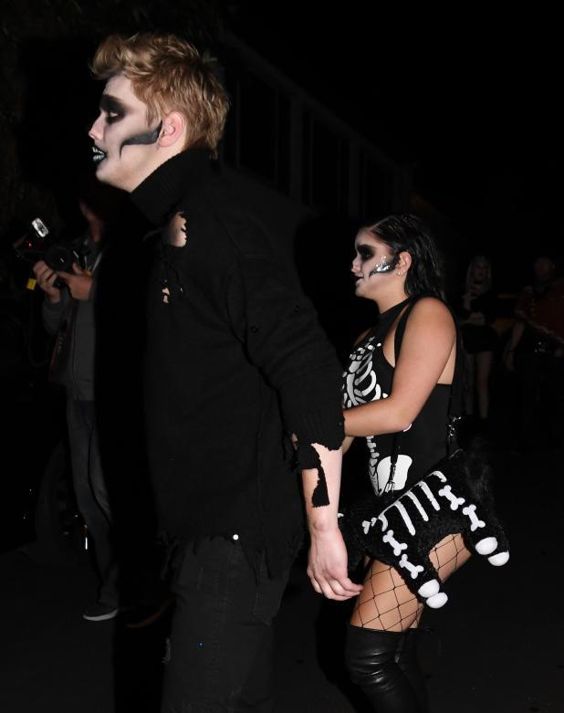 She also carried a black and white skeleton unicorn handbag
