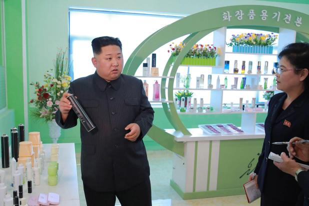Kim, famed for his bizarre hair style, appears to ask about an aerosol spray