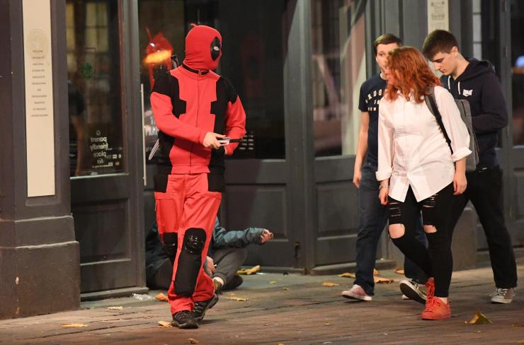 Deadpool speaks to new friends as he saunters down the road