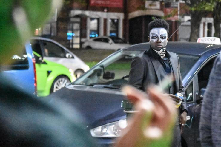 People didn't hold back with their face make up, with this Halloween party-goer having donned a skull mask