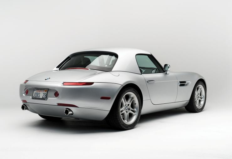 The car has accessories including a hardtop roof, car covers and manuals