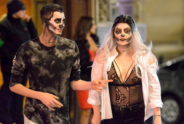 An undead couple matched their face make up for the Halloween celebrations