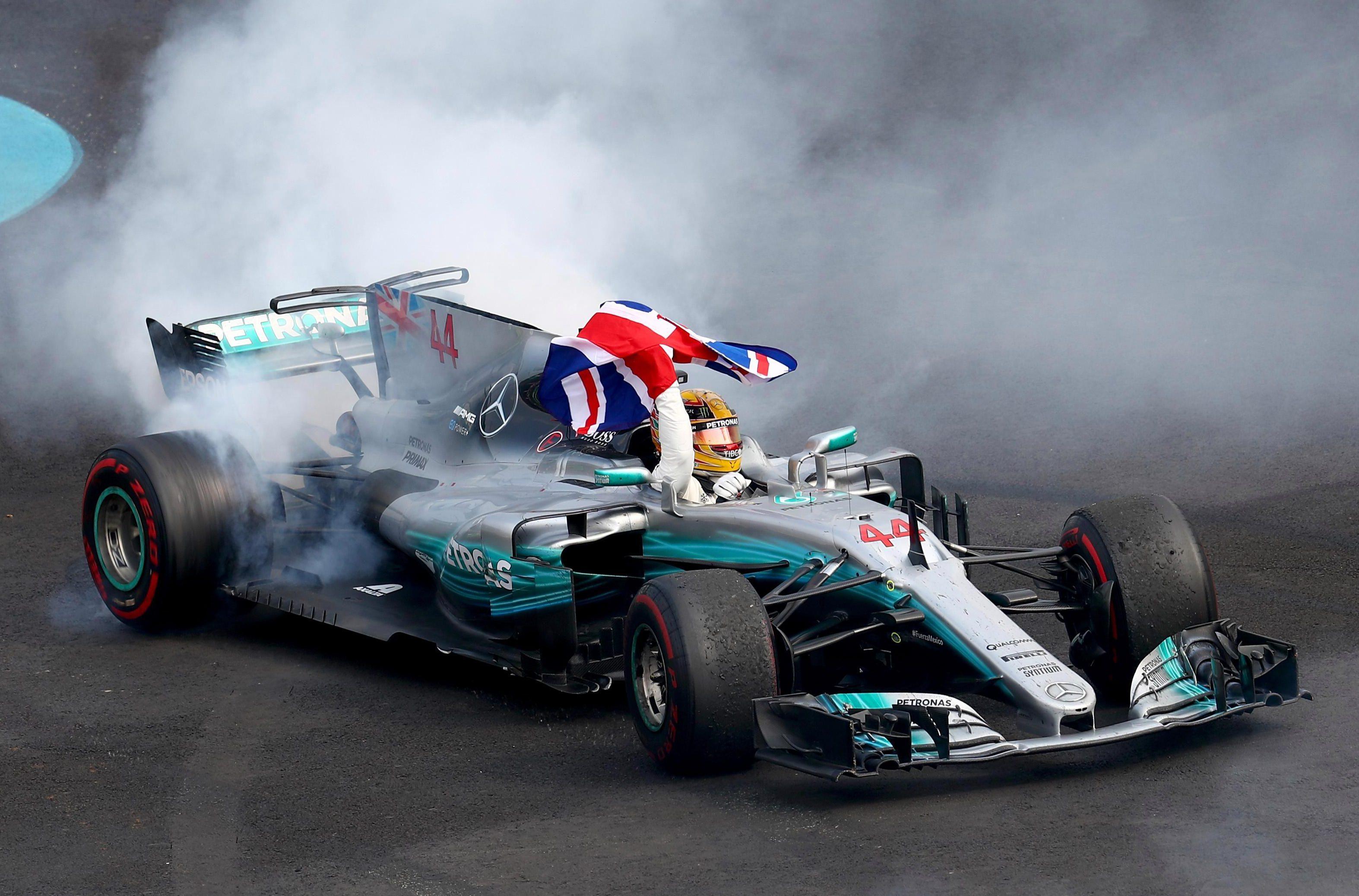 Lewis Hamilton celebrates crowning his fourth world crown