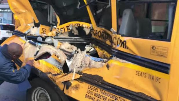 The damage caused to the side of the school bus when the suspect down a bike path and smashed into it