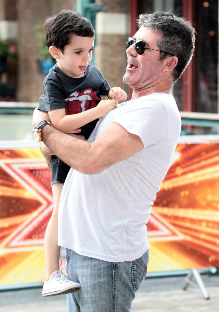 Simon said he hasn't told three-year-old son Eric about his fall