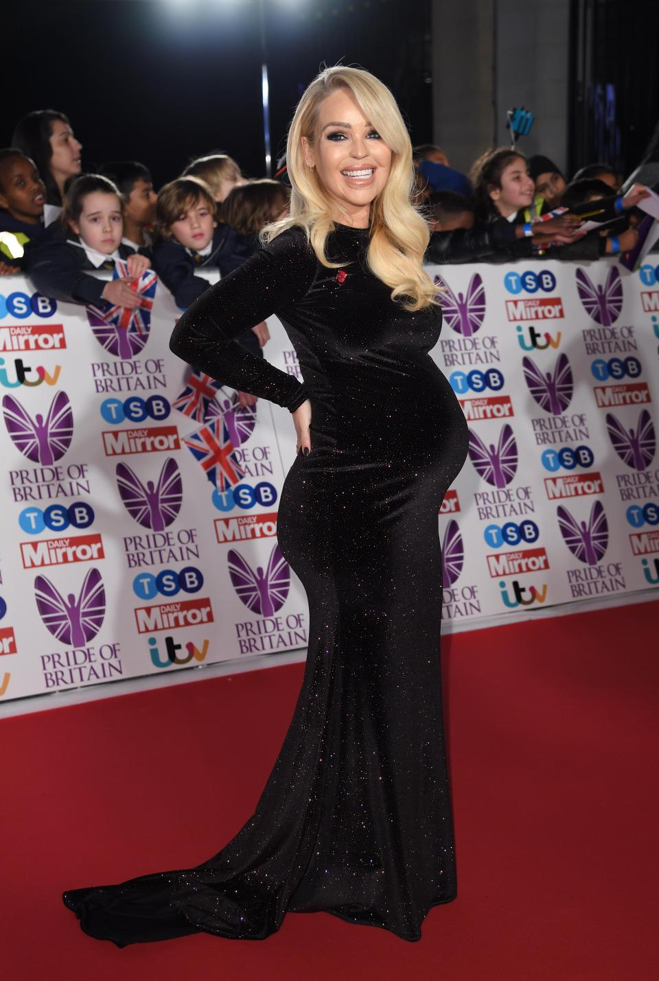 Katie shows off her baby bump at the Pride of Britain Awards