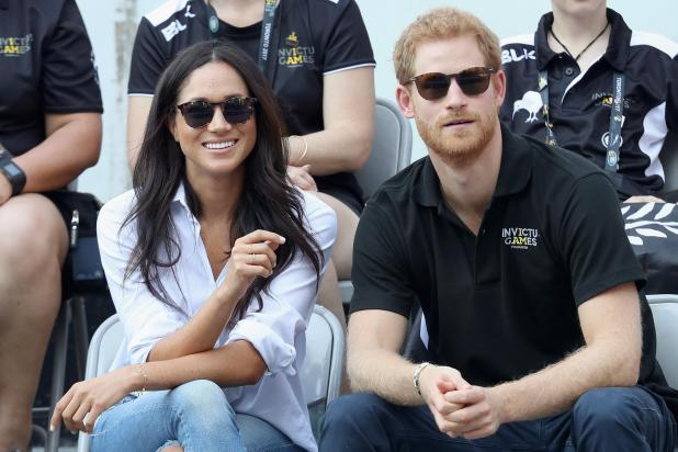 Smitten... Prince Harry and Meghan Markle attend a Wheelchair Tennis match during the Invictus Games 2017 at Nathan Philips Square