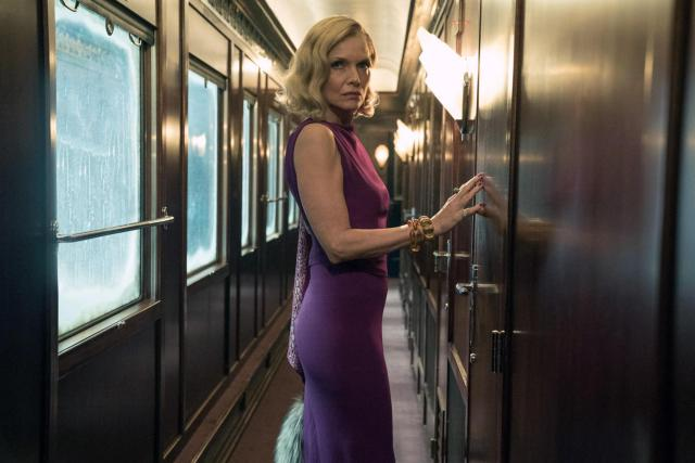 Michelle is making her return as a man-eating widow in Murder On The Orient Express