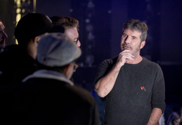Simon Cowell has returned to work on the X Factor, but a bruise was visible on his neck following his fall last week