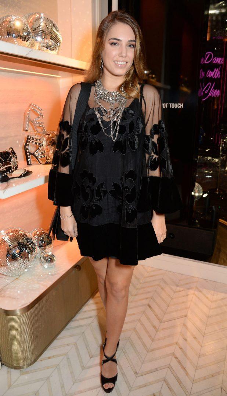 Amber Le Bon looked elegant in a black mini dress, adorned with velvet flowers
