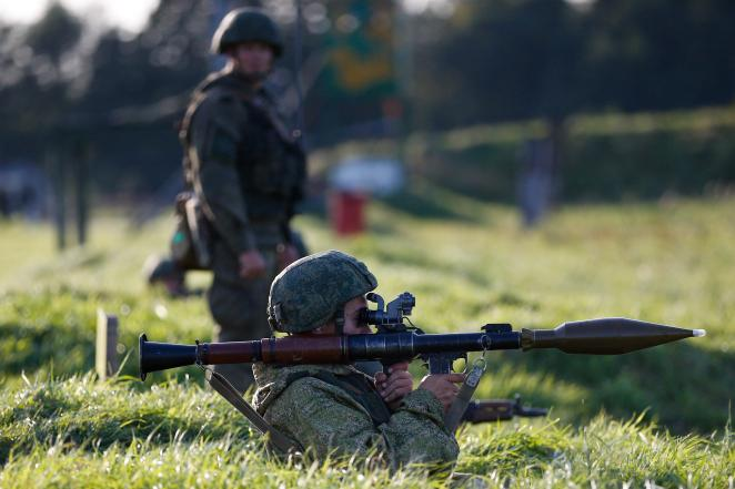 A Russian soldier takes aim with an RPG during September war games