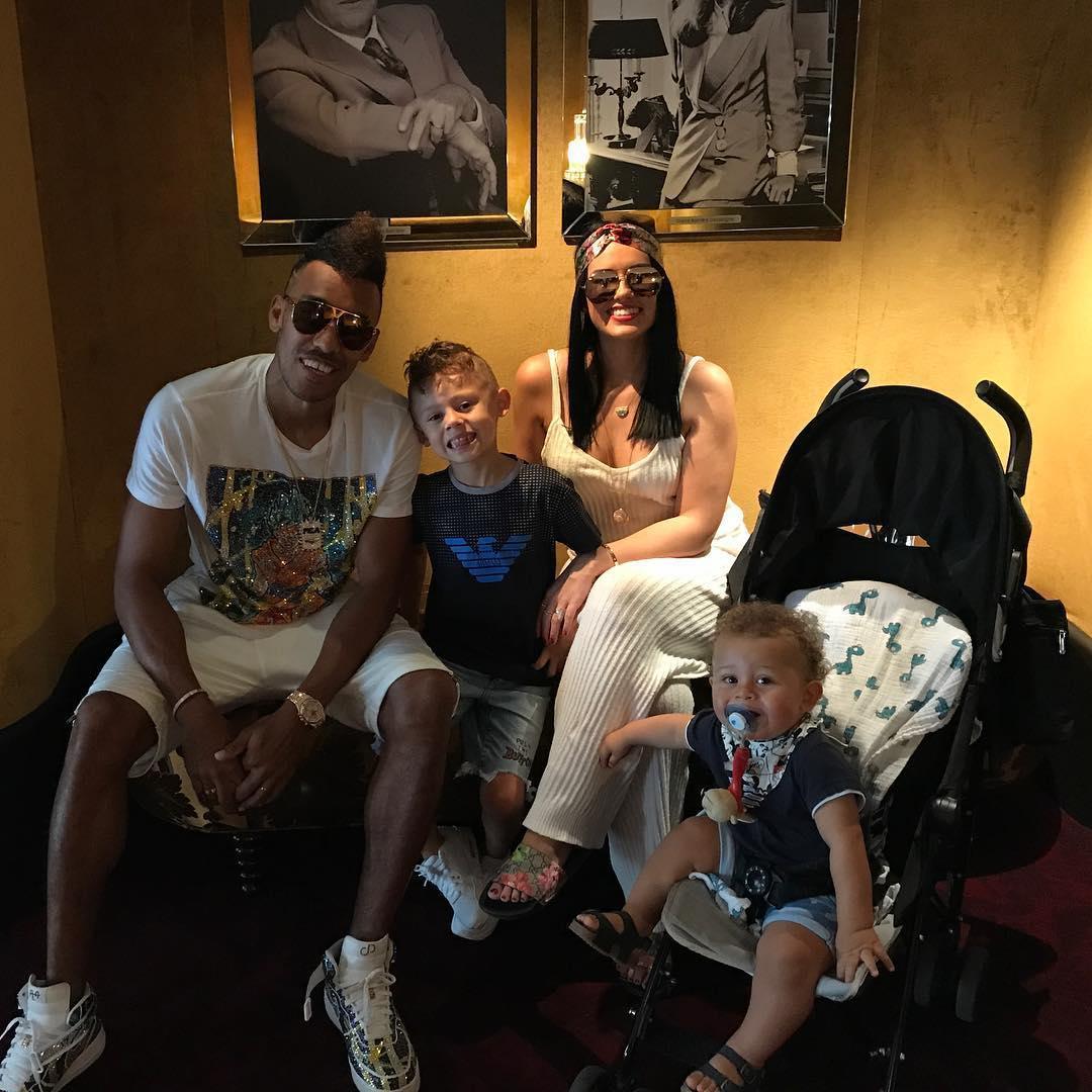 Pierre-Emerick Aubameyang poses with girlfriend Alysha Behague and his two children