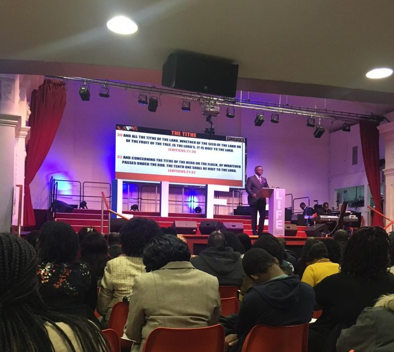 Our reporter saw Oshimolowo lead a service called 'The Power of the Tithe'