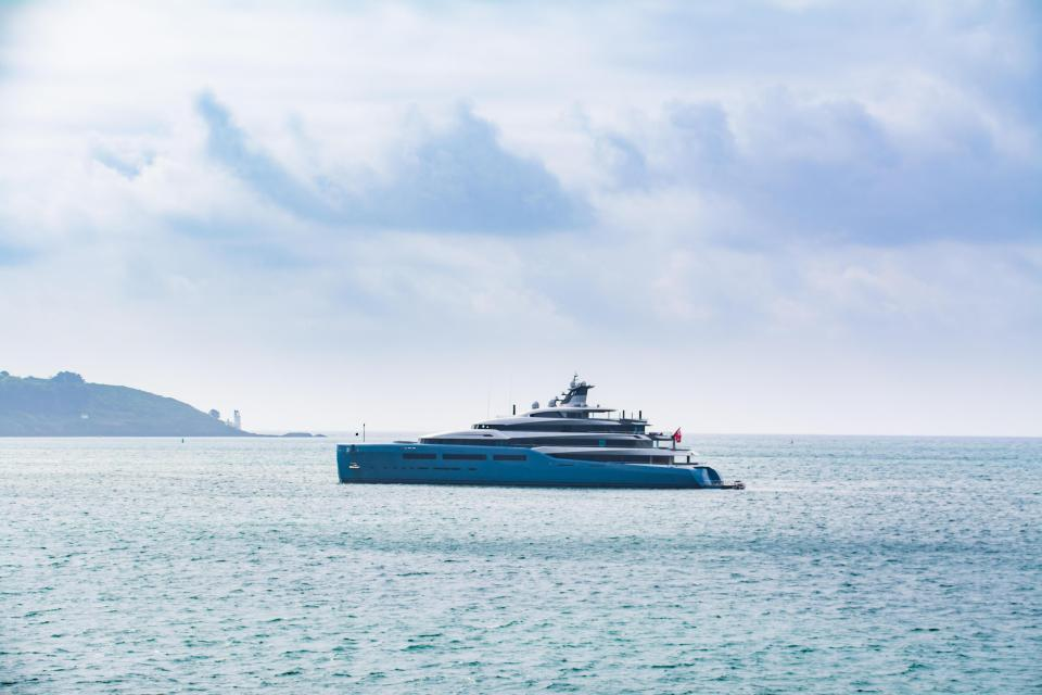 The mega yacht has a full-sized tennis court and can reach 23mph