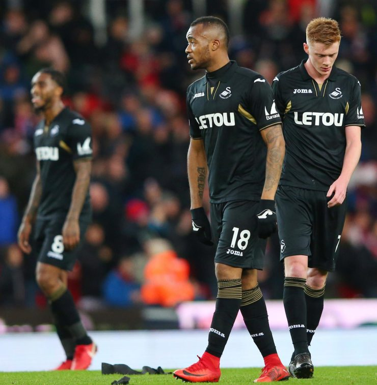 Dejected Swansea players troop off after their latest defeat at Stoke