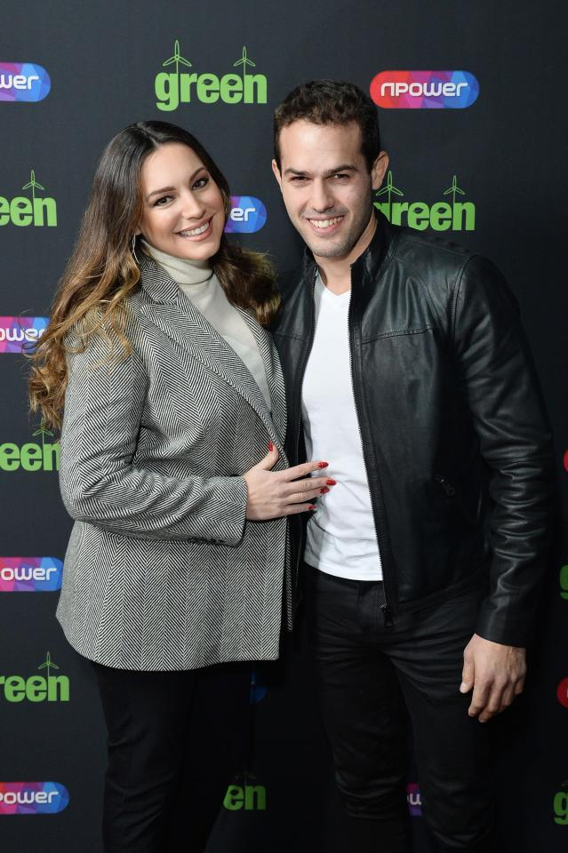 Kelly Brook poses with boyfriend Jeremy Parisi outside the venue where Blue played