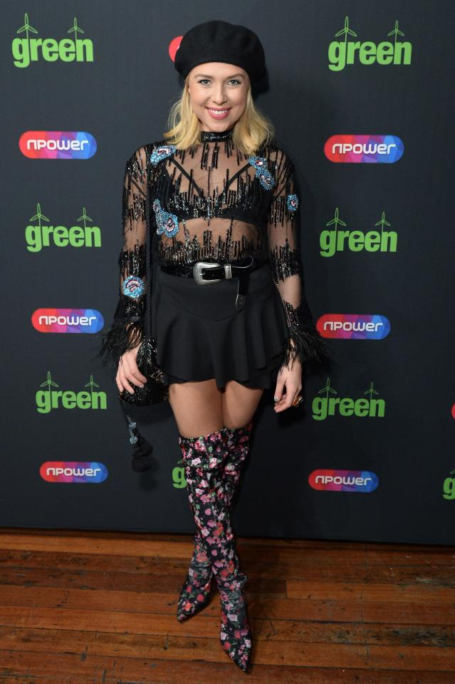 Gabby Allen looked spectacular in floral boots, a black beret and a sheer top