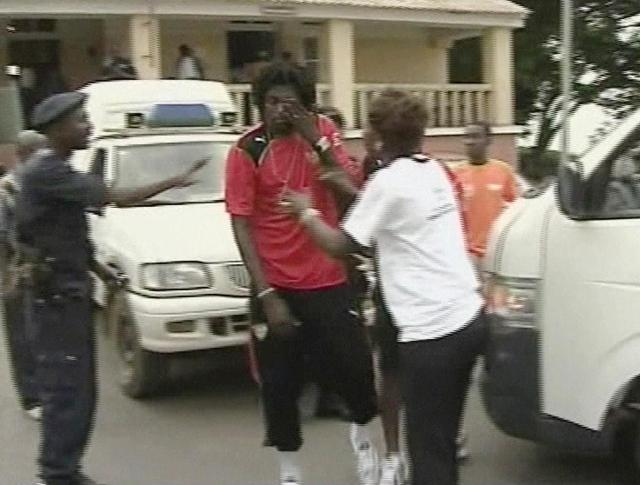 A distraught Adebayor is comforted after the attack