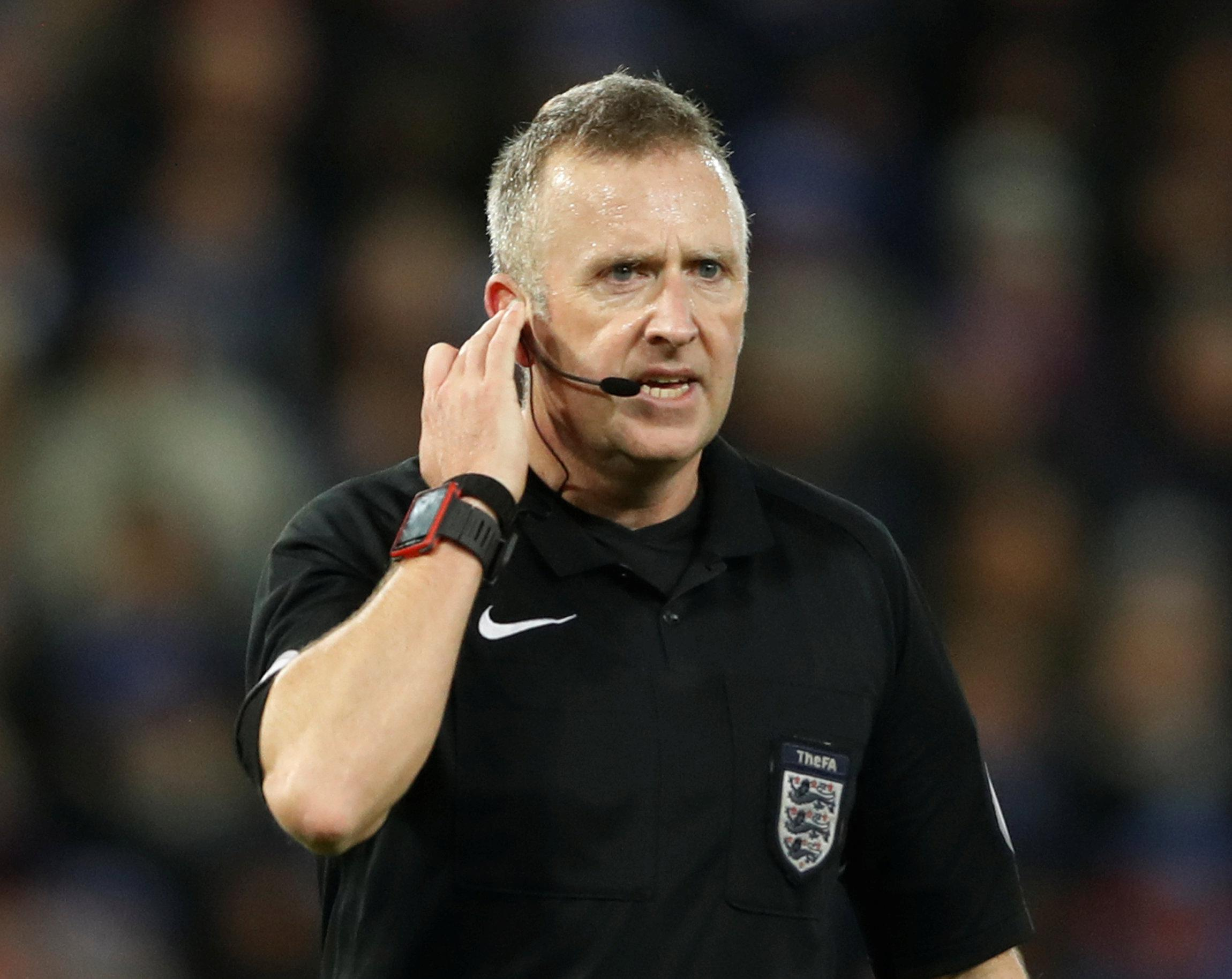 Referee Jon Moss makes use of VAR to check whether Kelechi Iheanacho's strike should stand
