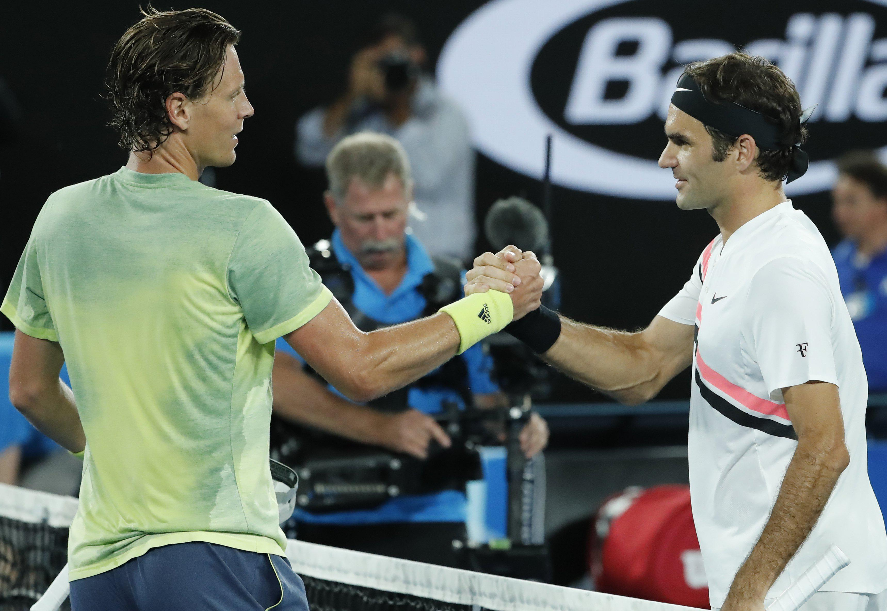 The two tennis stars embrace at the net in what was a comfortable passage through for Federer