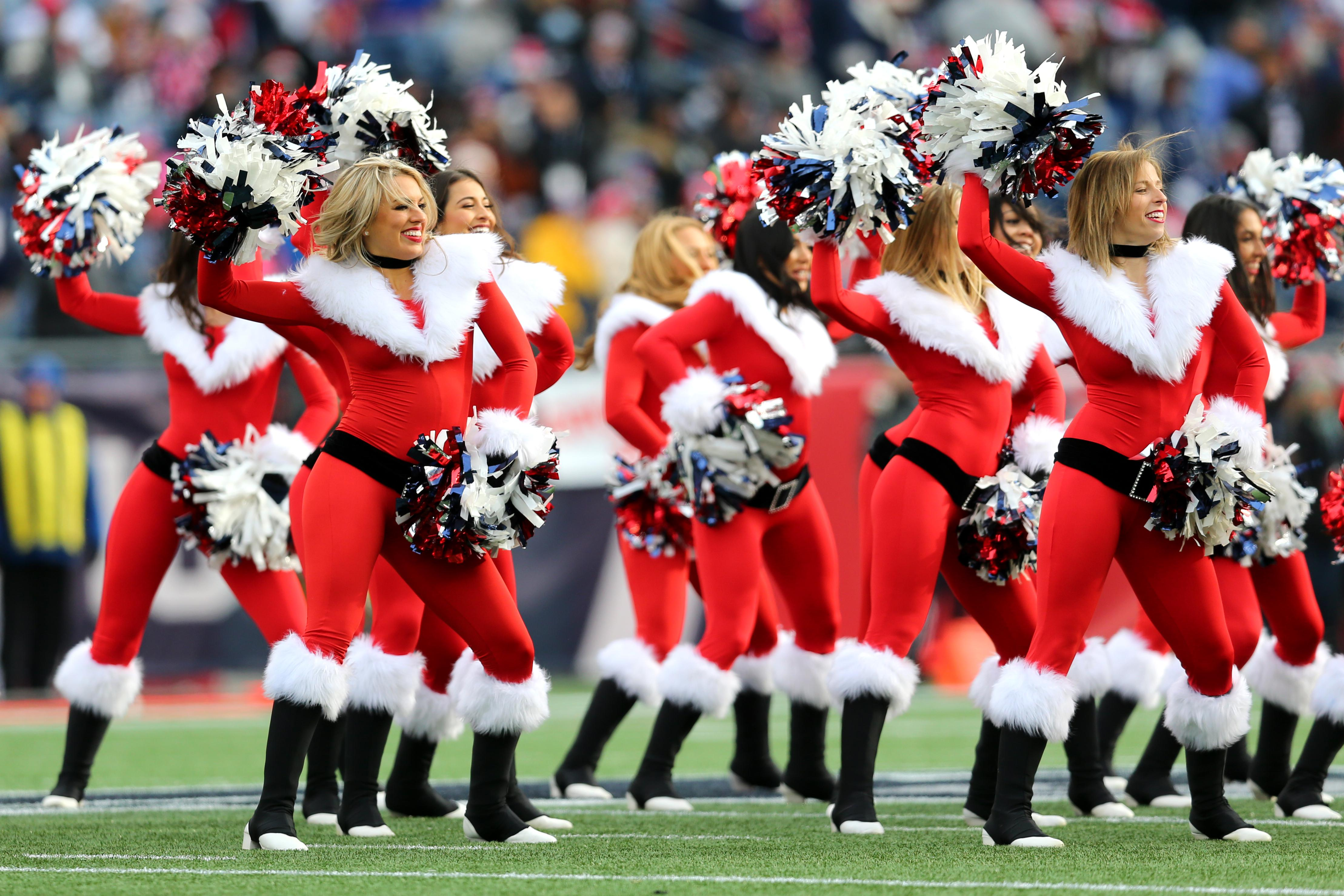 Patriots cheerleaders dressed up in Christmas outfits