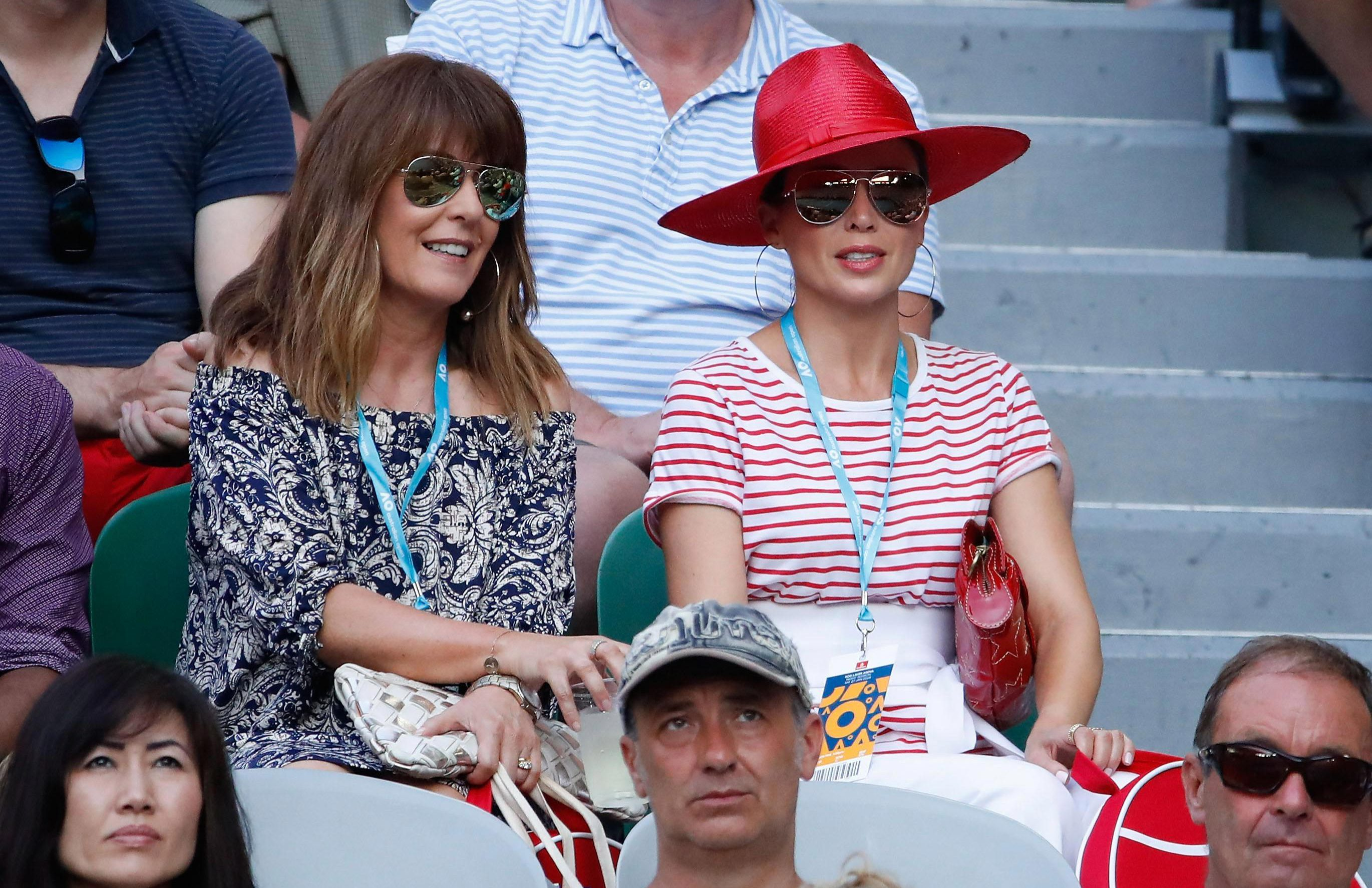 Dannii Minogue was in the crowd in a bright red hat as she watched Simona Halep take on Caroline Wozniacki
