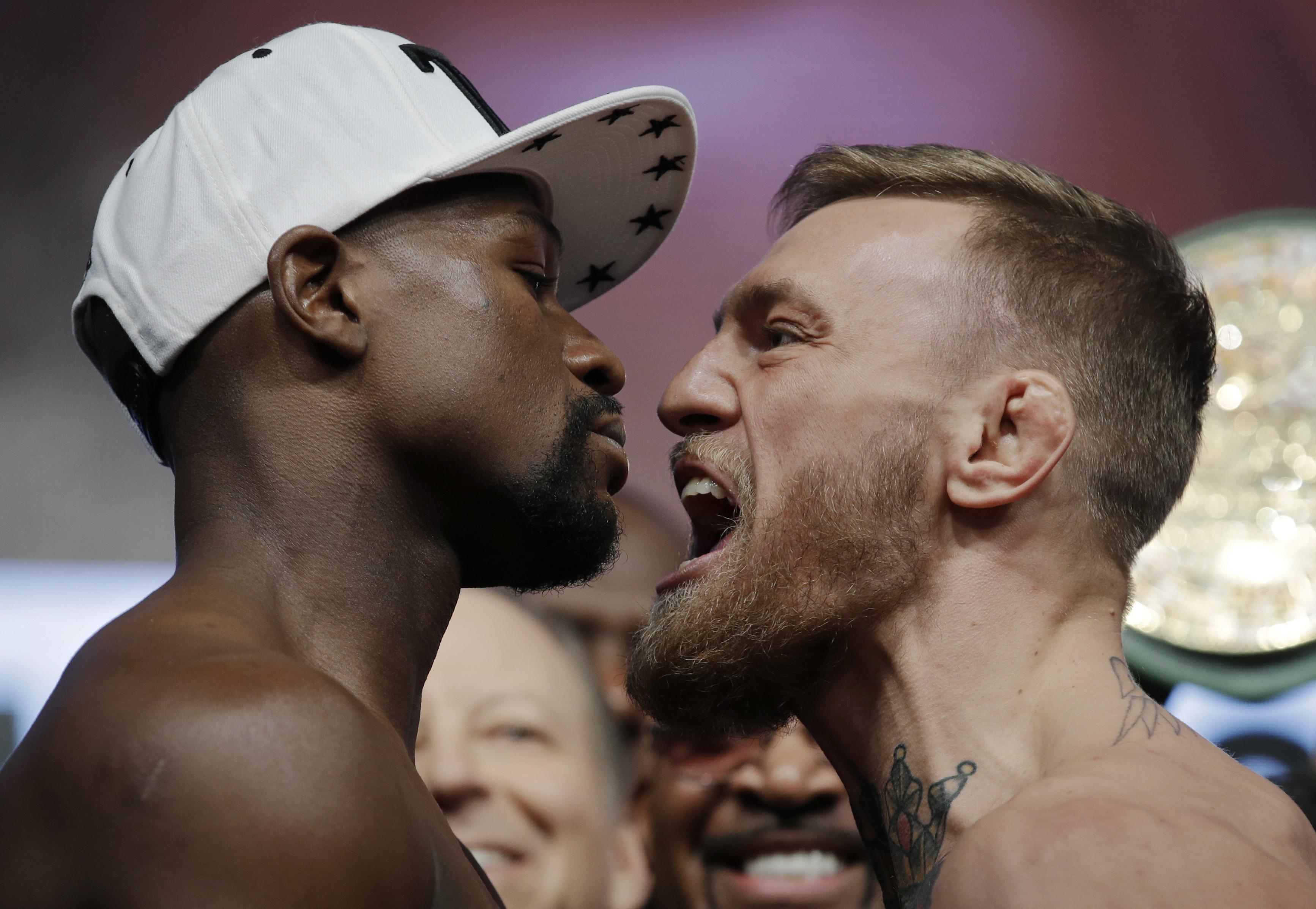 Conor McGregor has urged Floyd Mayweather to join him in the Octagon