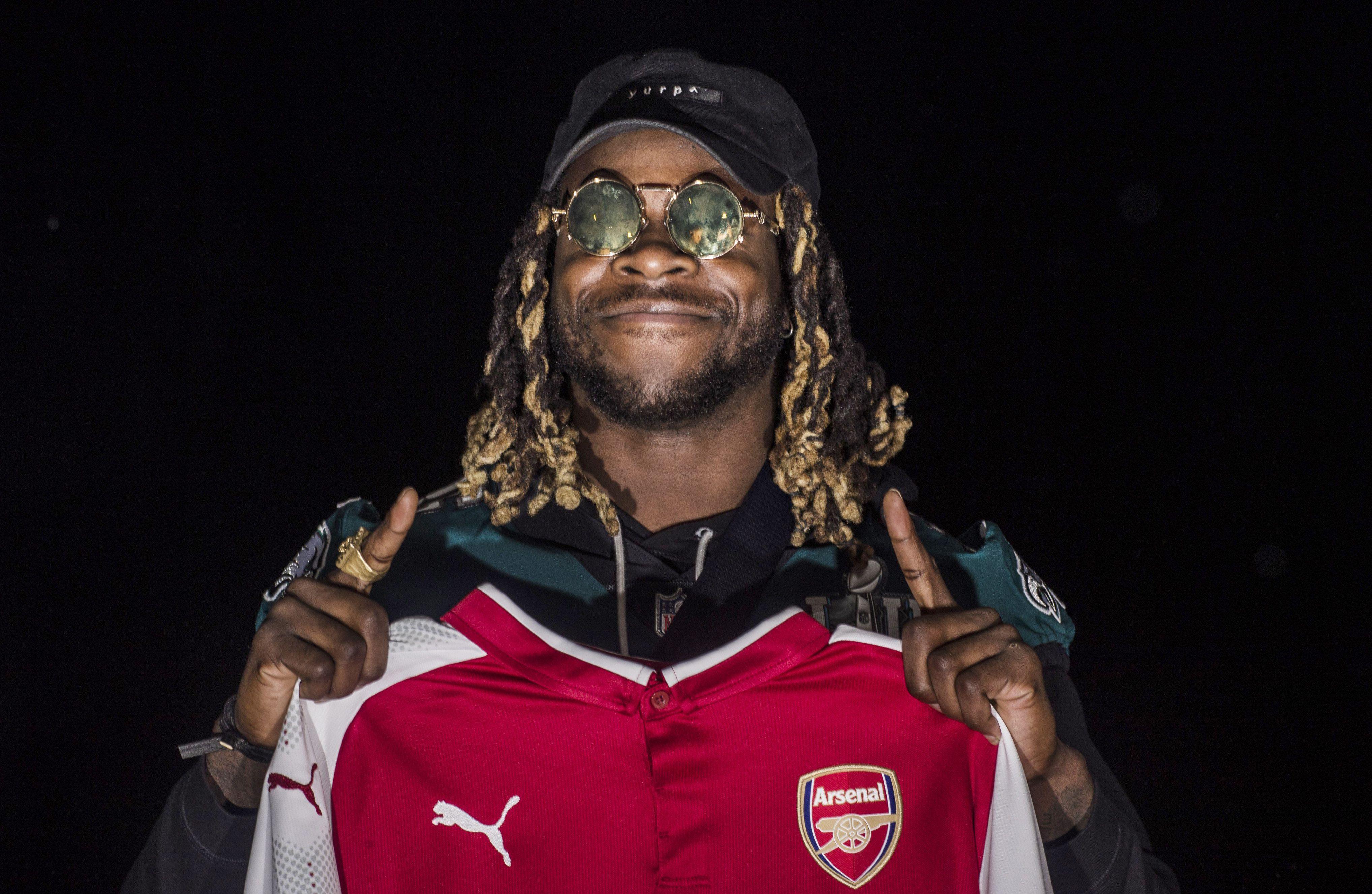Ajayi holds aloft an Arsenal kit