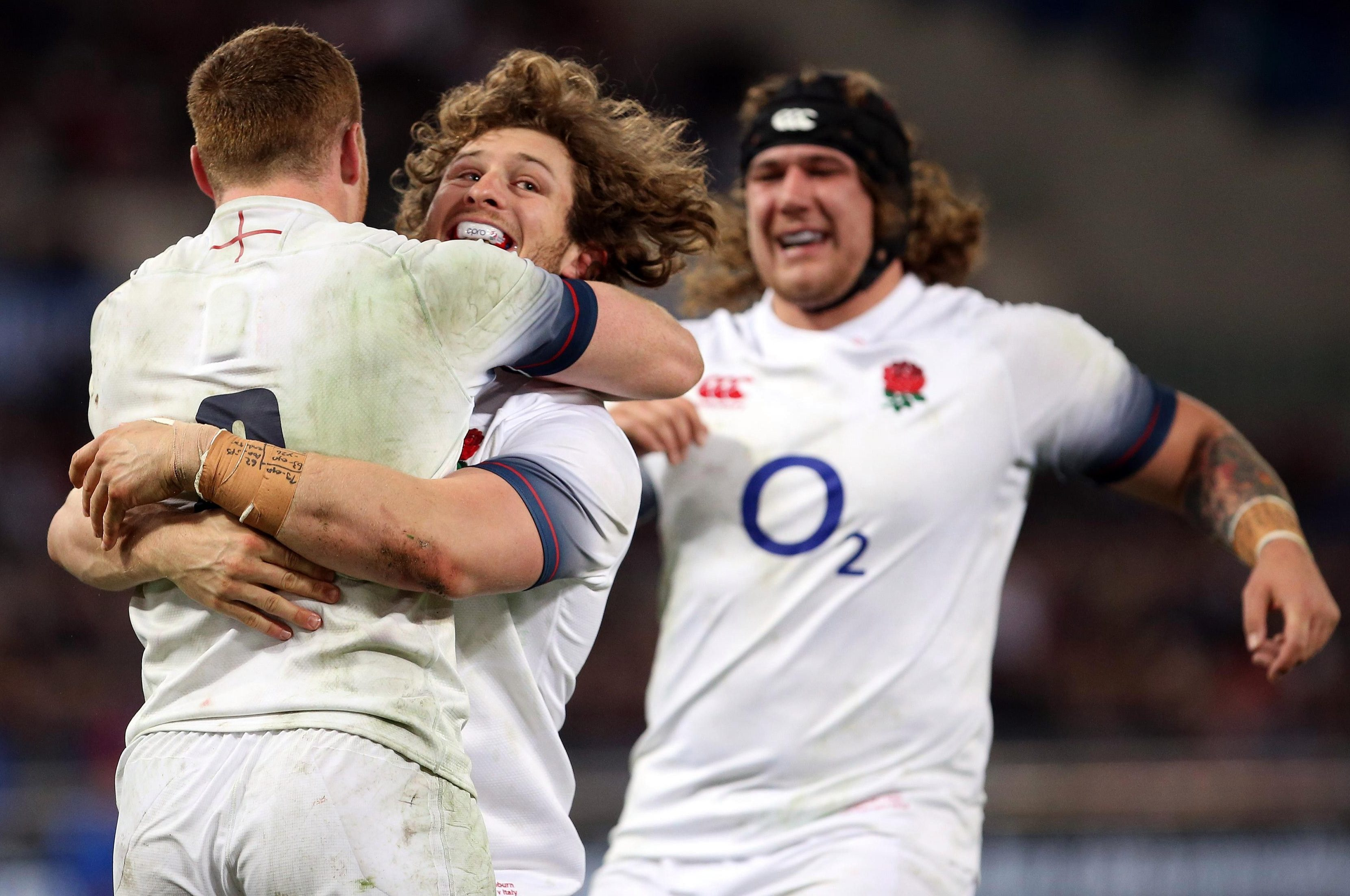 Sam Simmonds, Alec Hepburn and Harry WIlliams celebrate after scoring a try against Italy