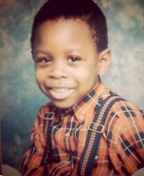 Ajayi as a youngster in a red shirt and braces