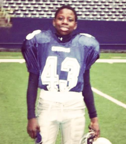 Ajayi pictured in full gridiron kit as a youngster