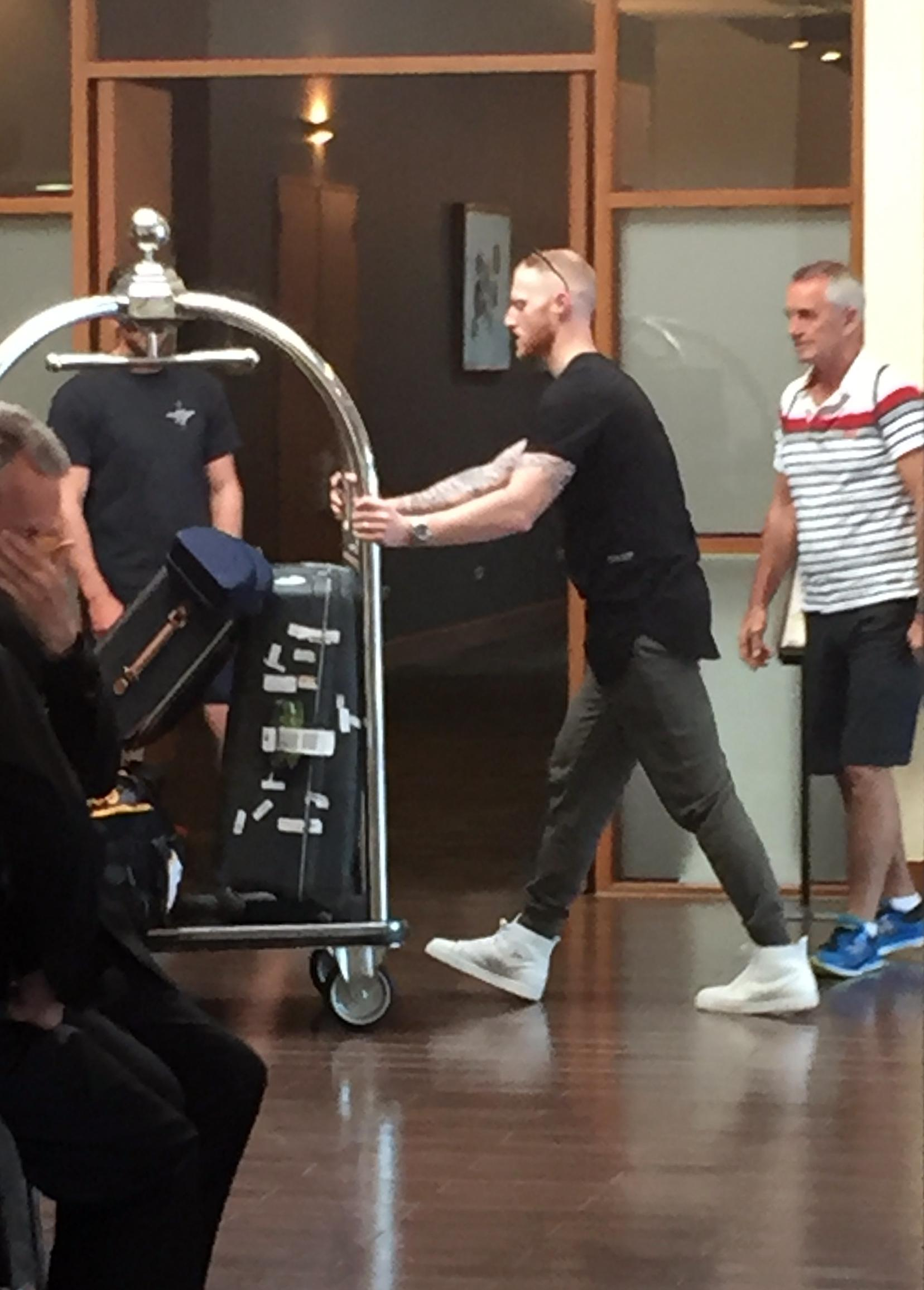 Stokes is later seen in the hotel wheeling his bags towards his room