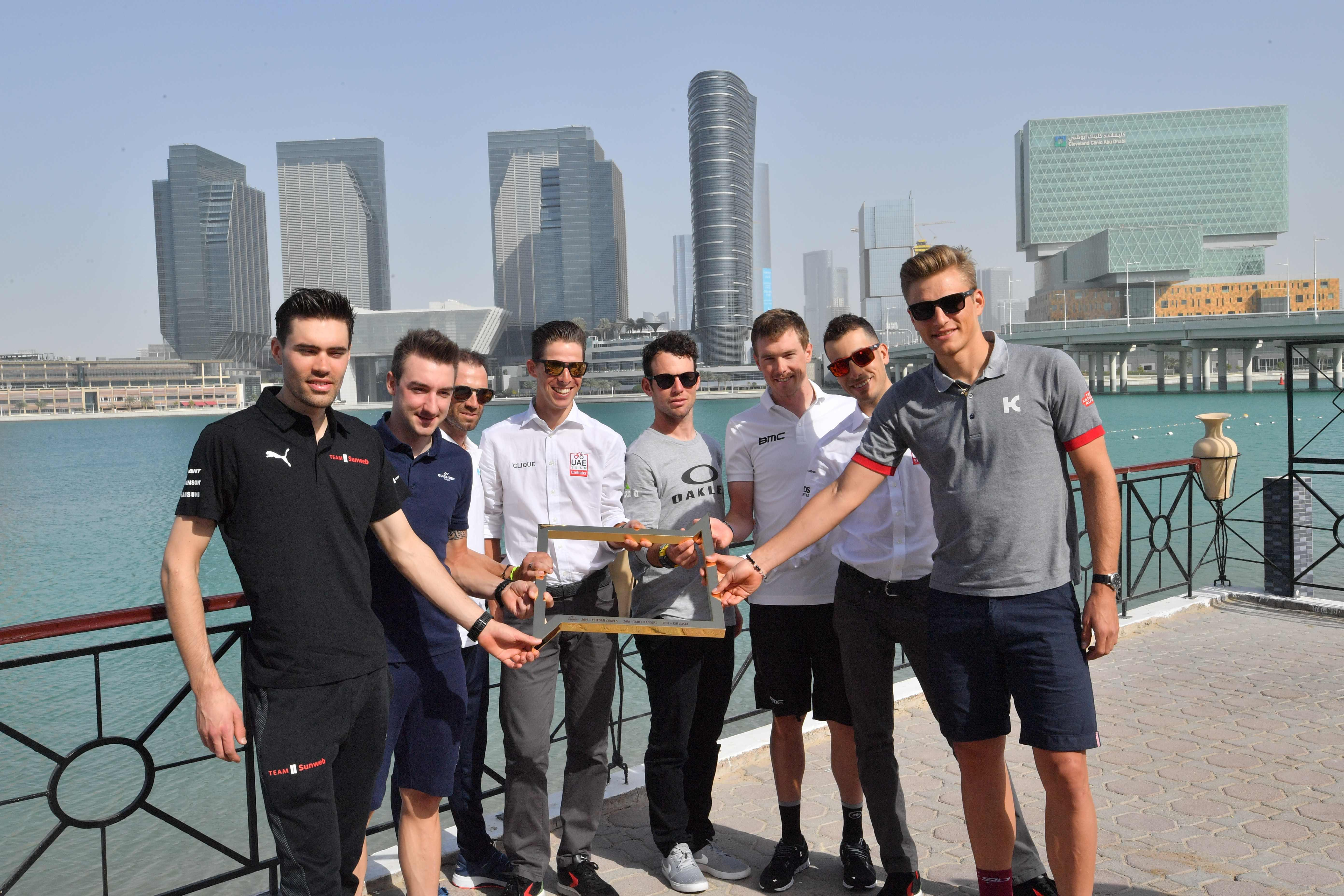 Mark Cavendish poses with the trophy before the start of the Abu Dhabi Tour