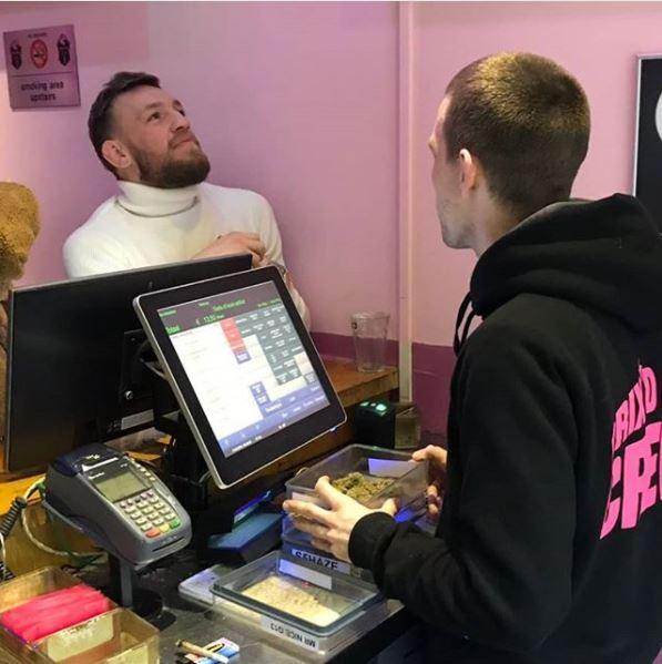 Conor McGregor was snapped paying a visit to a Amsterdam coffee shop on Sunday, with a huge box of weed just inches away from him