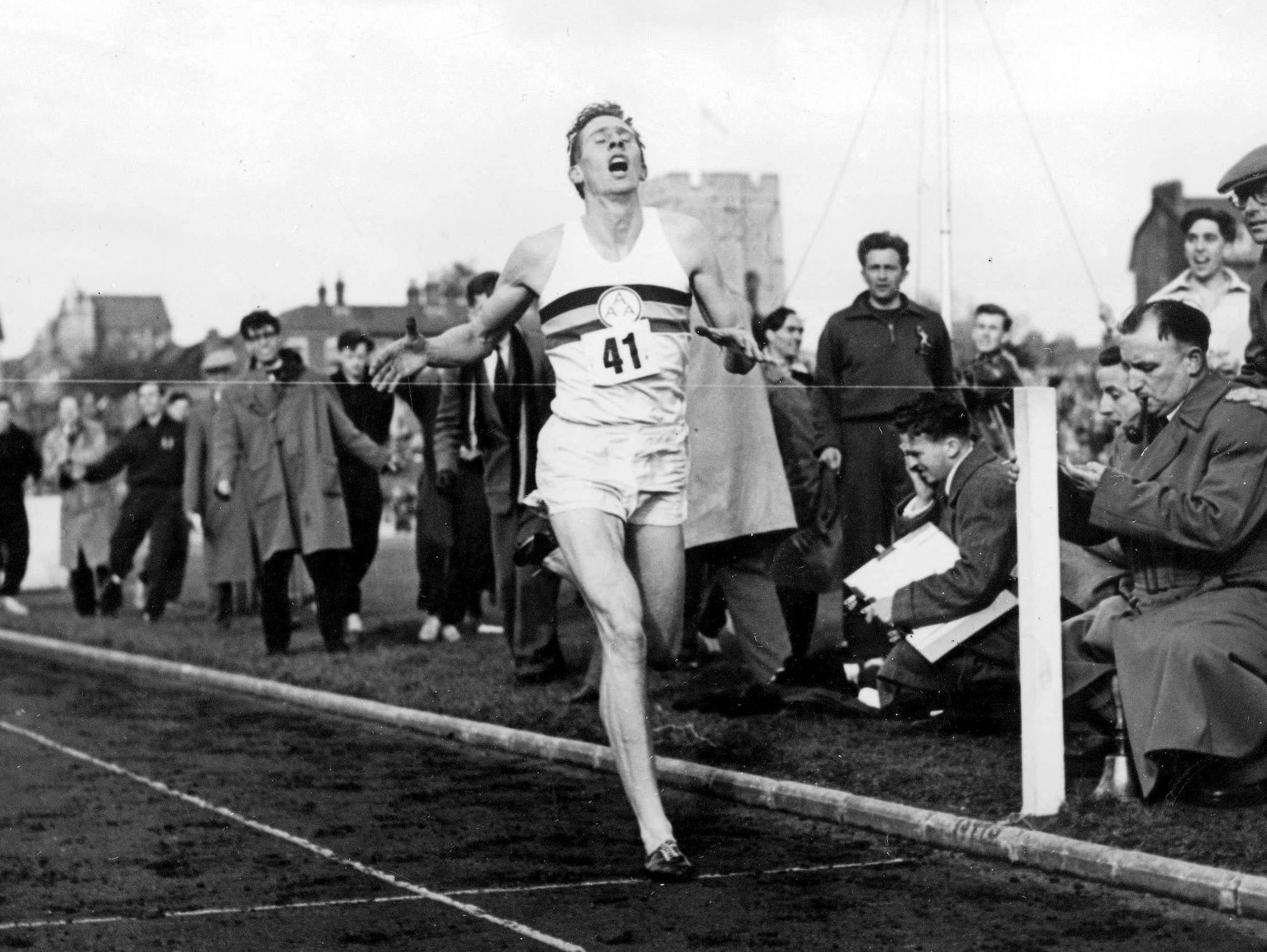 The moment Roger Bannister broke the 4 minute mile - completing his run in 3mins 59secs
