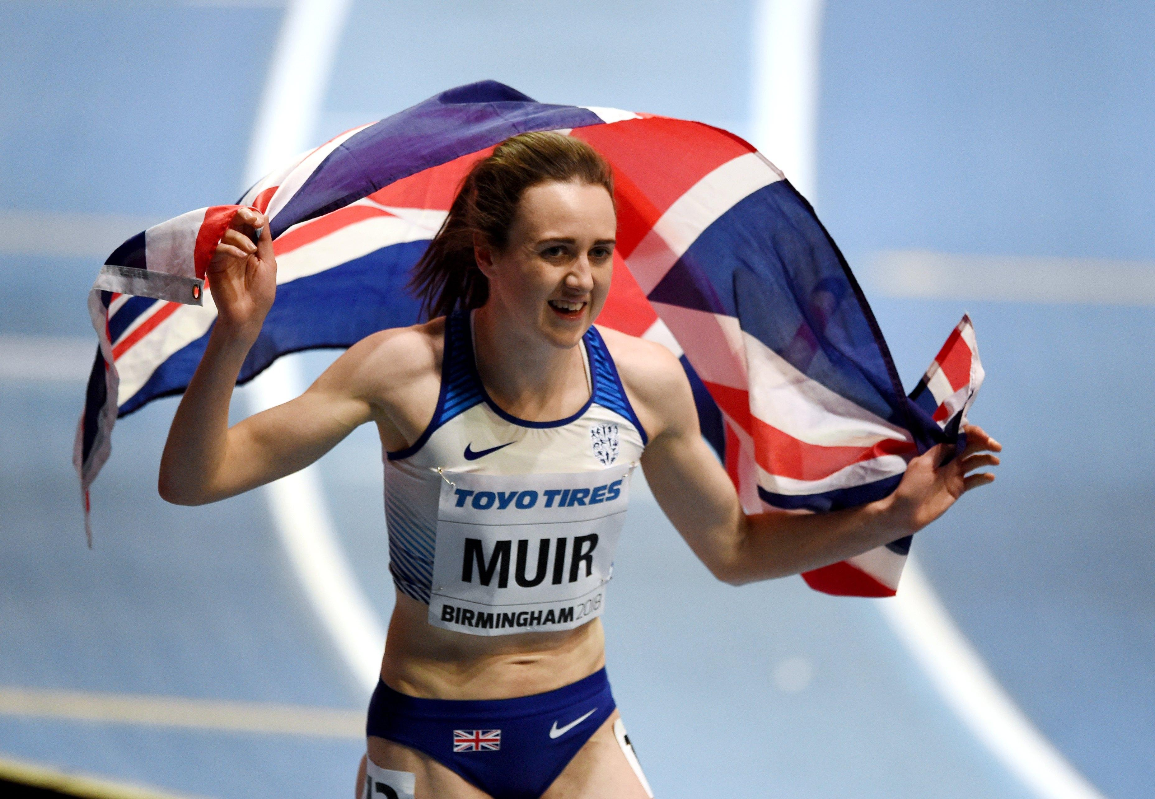Laura Muir celebrates with the Union Jack after winning bronze at the world indoors in the 3,000 metres