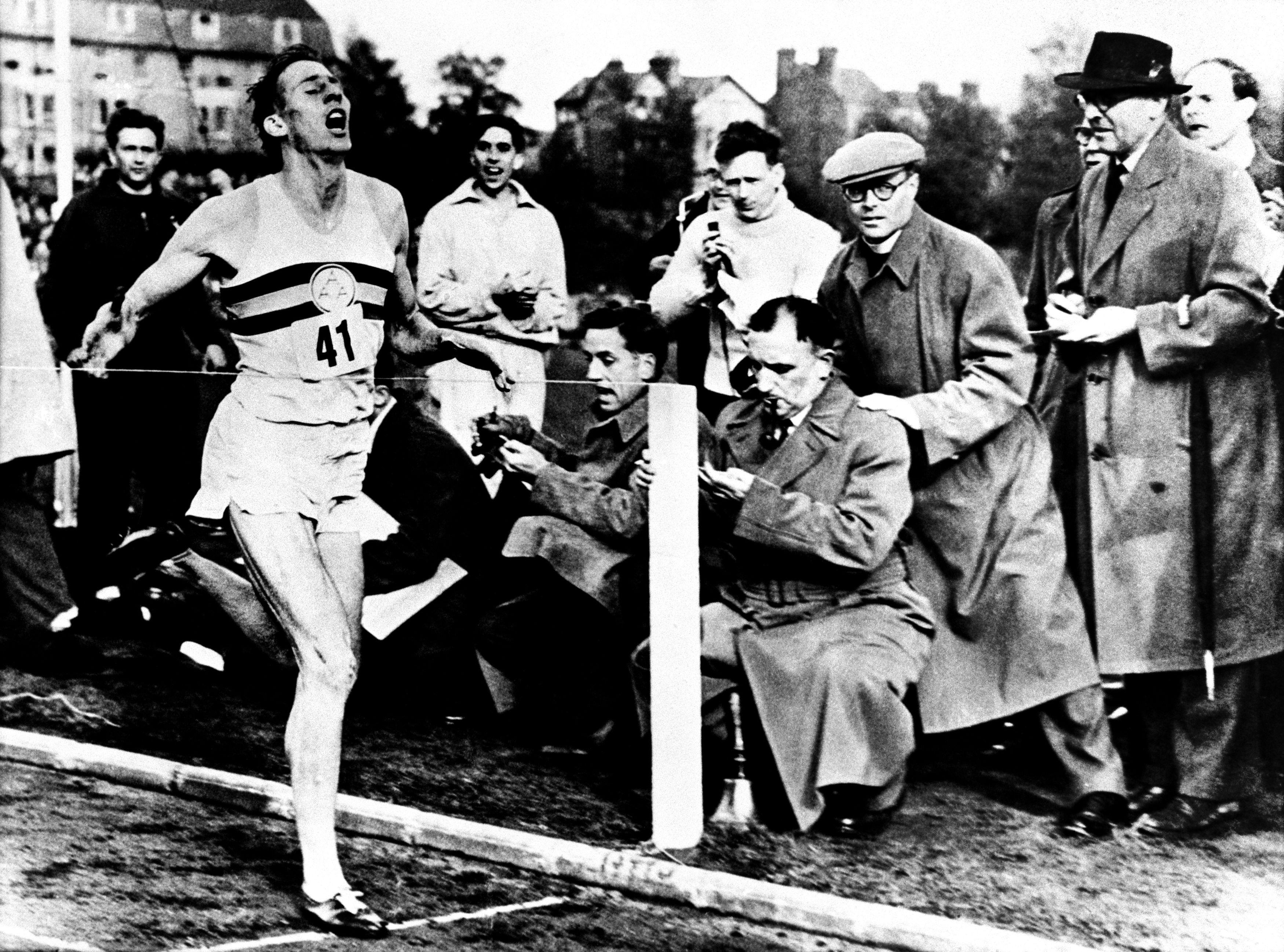Roger Bannister hits the tape at the Oxford track where he completed a mile in under four minutes