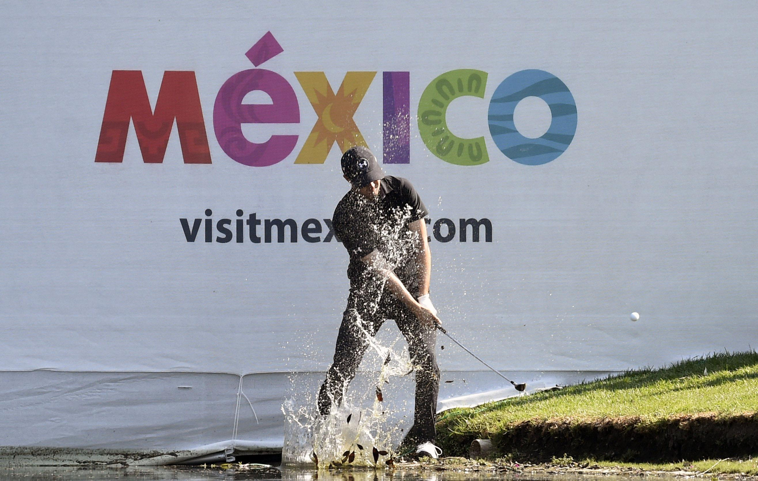 Jordan Spieth plays out of the water in Mexico