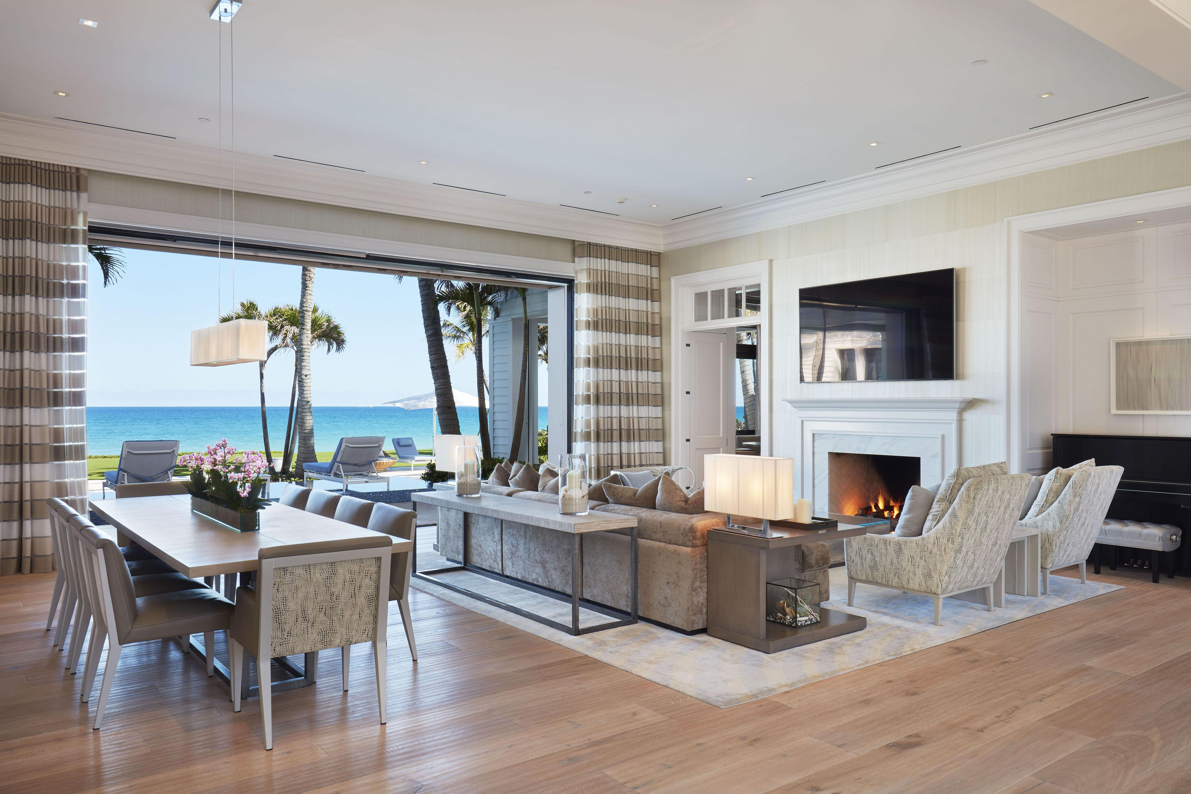 Gorgeous living room has plenty of space to sit down with a TV and fireplace in-built in the wall