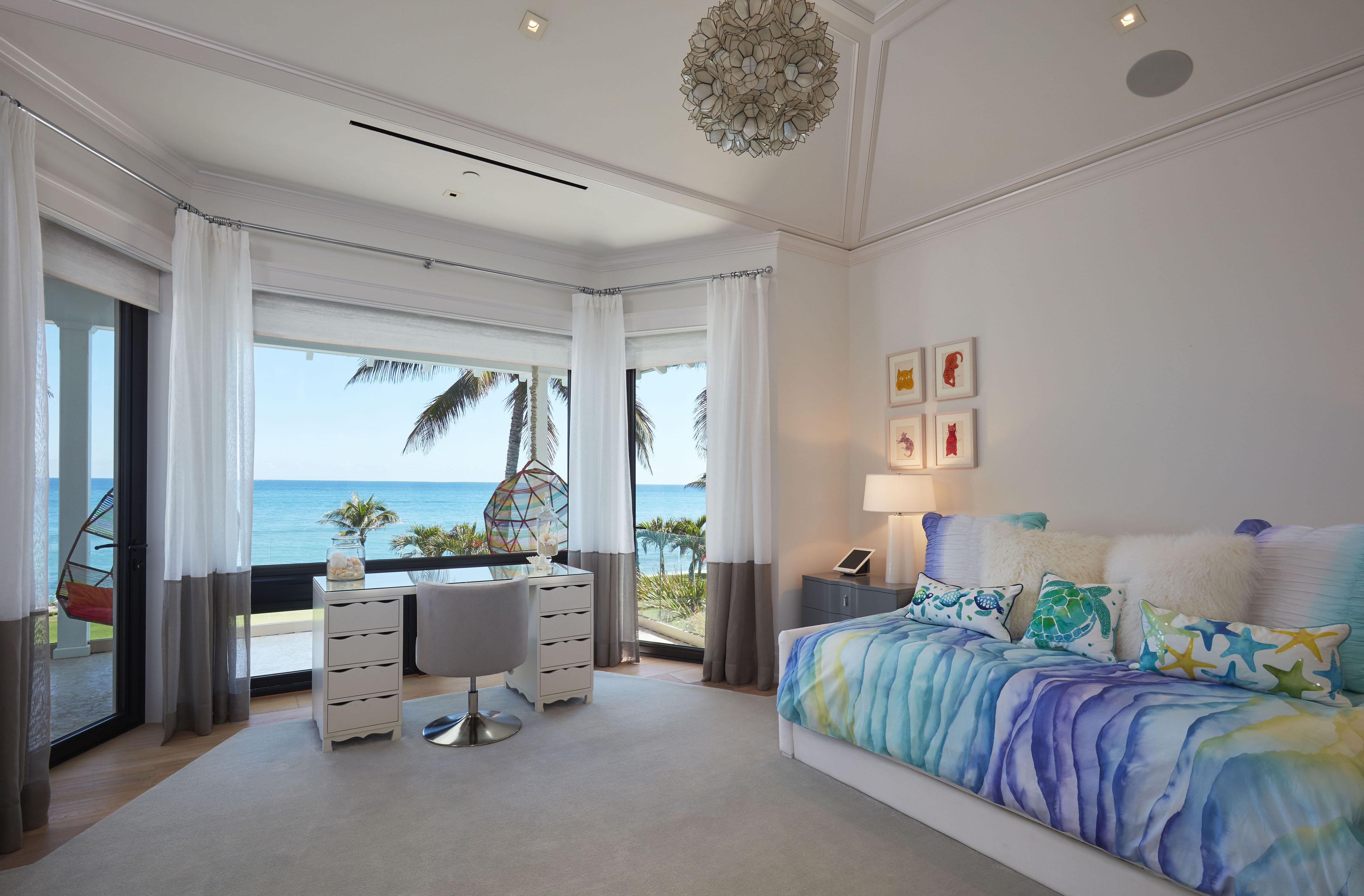 A study desk overlooks the ocean in one fantastic room