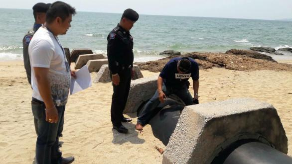 A crack team of police officers investigate the scene of the crime in Thailand